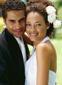 side profile of a bride and groom smiling